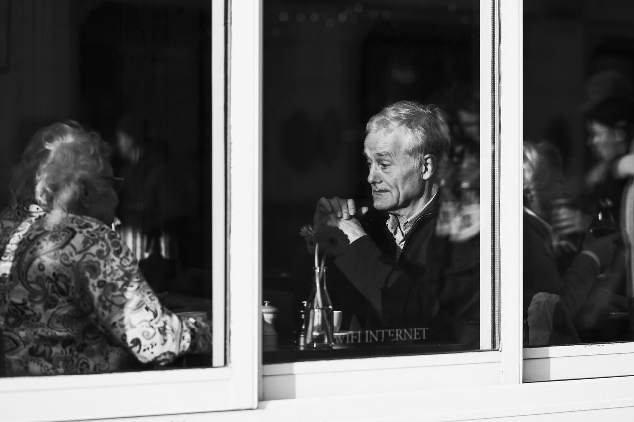 Senior Adult Window Mature Adult Gray Hair EyeEm Best Shots EyeEm Masterclass The EyeEm Facebook Cover Challenge Candid Monochrome Photography Blackandwhite Monochrome EyeEm Best Shots - Black + White EyeEm Bnw Amsterdam Street Photography