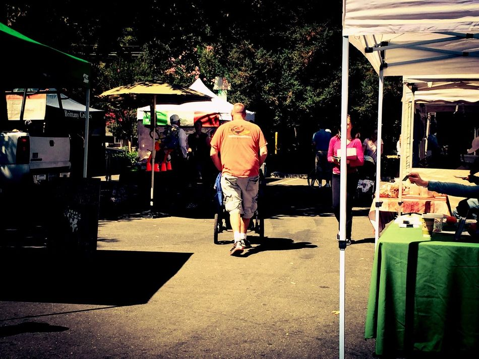 Fatherhood Moments Father Baby Stroller Walking Road People Woman Man Tent Umbrella Food Produce Booth Farm Markets San Francisco East Bay California Father And Daughter Father & Son Table Table Cloth Market Street Backgrounds Trees People And Places