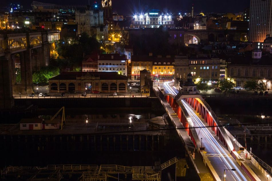 Architecture Bridge Building Exterior Built Structure Capital Cities  City City Life City Street Cityscape Illuminated Light Trail Long Exposure Modern Motion Newcastle Newcastle Upon Tyne Night No People Office Building Outdoors Road Swivel Bridge Traffic Travel Destinations