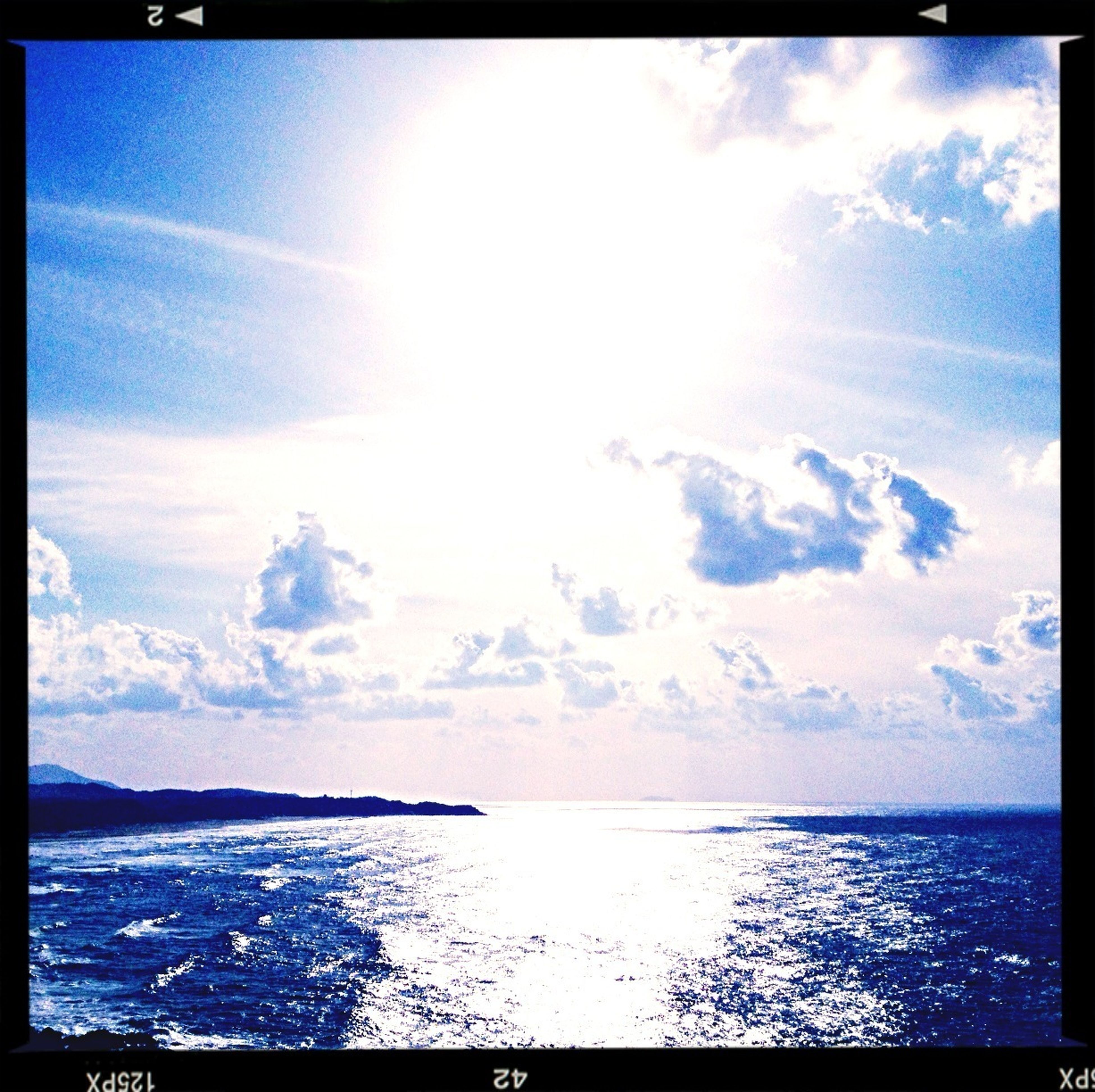 transfer print, water, sea, auto post production filter, horizon over water, sky, scenics, beauty in nature, tranquil scene, tranquility, nature, waterfront, cloud - sky, blue, idyllic, sun, sunlight, sunbeam, cloud, seascape