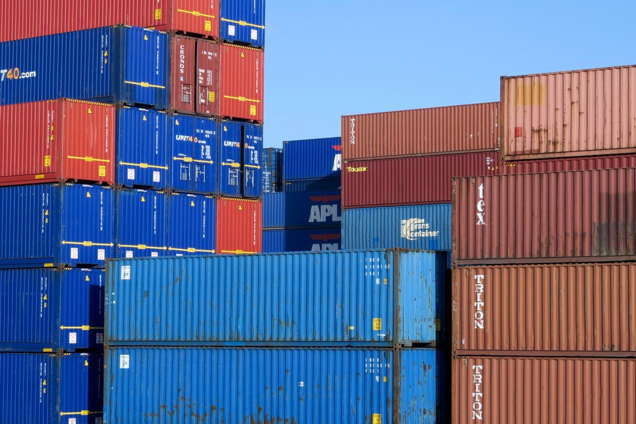 Business Cargo Container Commercial Dock Container Container Ship Distribution Warehouse Freight Transportation Harbor Industry Large Group Of Objects Manual Worker Manufacturing Multi Colored Nautical Vessel Occupation Outdoors Pier Shipping  Shipyard Sky Stack Trading Transportation Warehouse Yard
