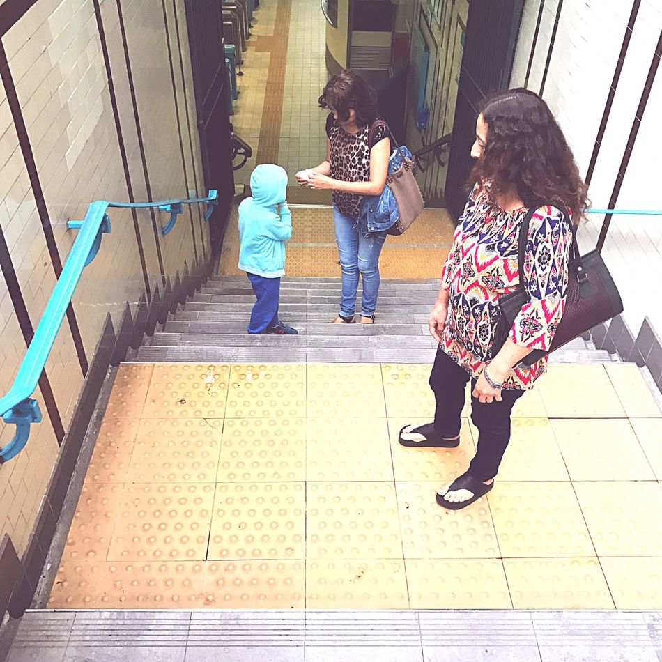 Lifestyles Females Full Length Women Steps Girls Togetherness Family Staircase Outdoors Baby People Adult Steps And Staircases Real People Day Young Adult Subway Stairwell Stairway Subway Subway Station People And Places Standing