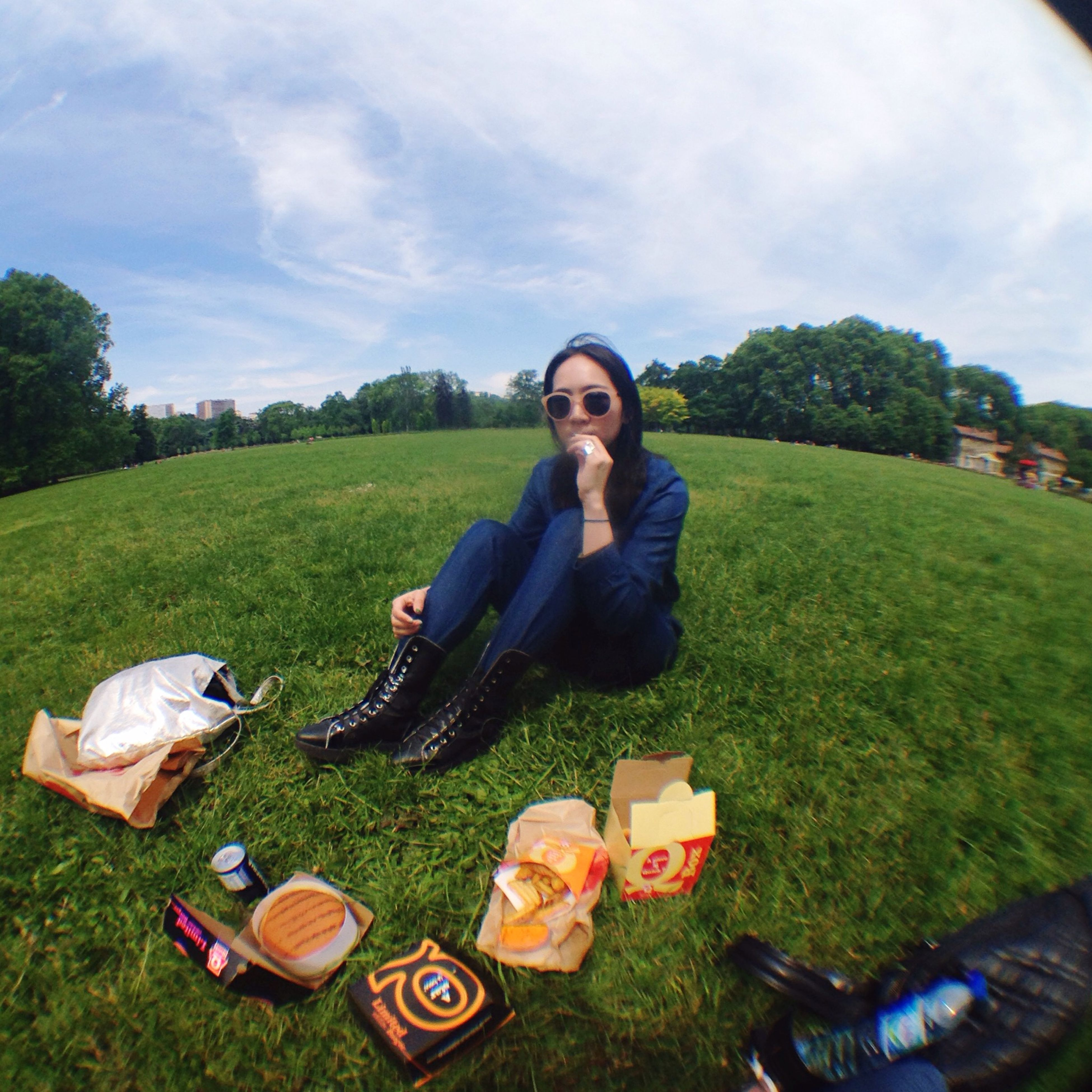 young adult, lifestyles, person, looking at camera, leisure activity, casual clothing, portrait, young women, smiling, grass, sitting, front view, happiness, tree, field, sunglasses, waist up