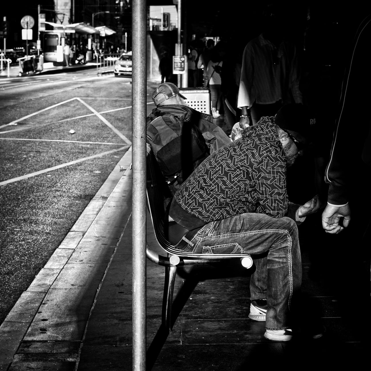 While the city awakes, some await... Sitting Adults Only Real People People Day Outdoors Eye4photography  Bnwphotography Bnw EyeEm Best Shots - Black + White EyeEm Gallery EyeEm Best Shots Monochrome Blackandwhite Photography Blackandwhite Black And White Black & White Sony A6000 Close-up Light And Shadow Bnw_globe Bnw_society Bnw_captures Bnw_worldwide Urban