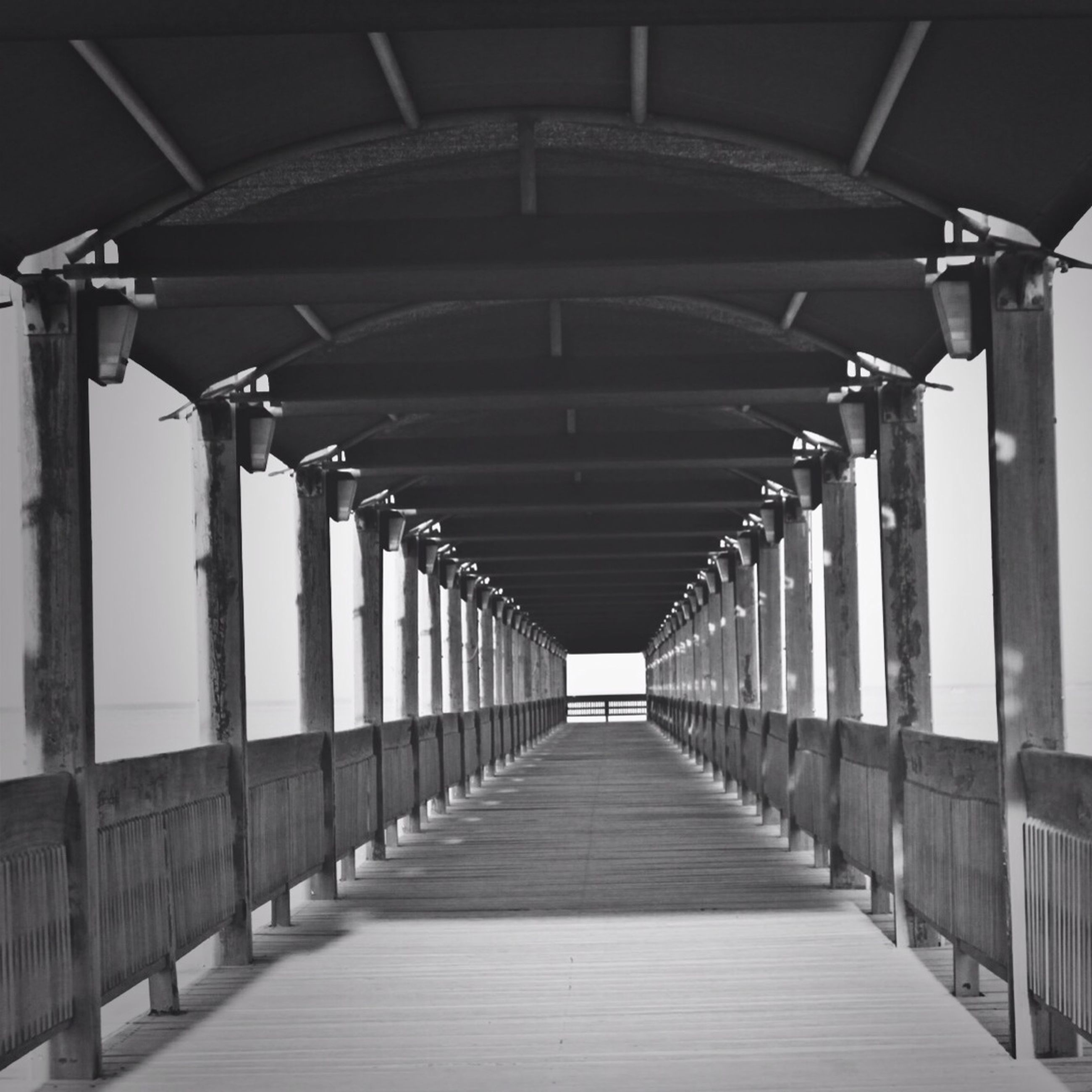 the way forward, architecture, built structure, diminishing perspective, in a row, indoors, railing, vanishing point, corridor, empty, repetition, long, architectural column, colonnade, narrow, ceiling, column, absence, no people, pattern