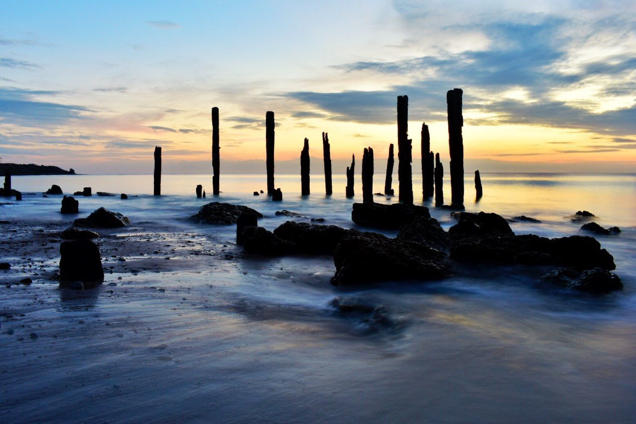 Sunset Sea Water Sky Nature Horizon Over Water Beauty In Nature Tranquility Scenics Beach Cloud - Sky Tranquil Scene Cold Temperature No People Wooden Post Outdoors Day
