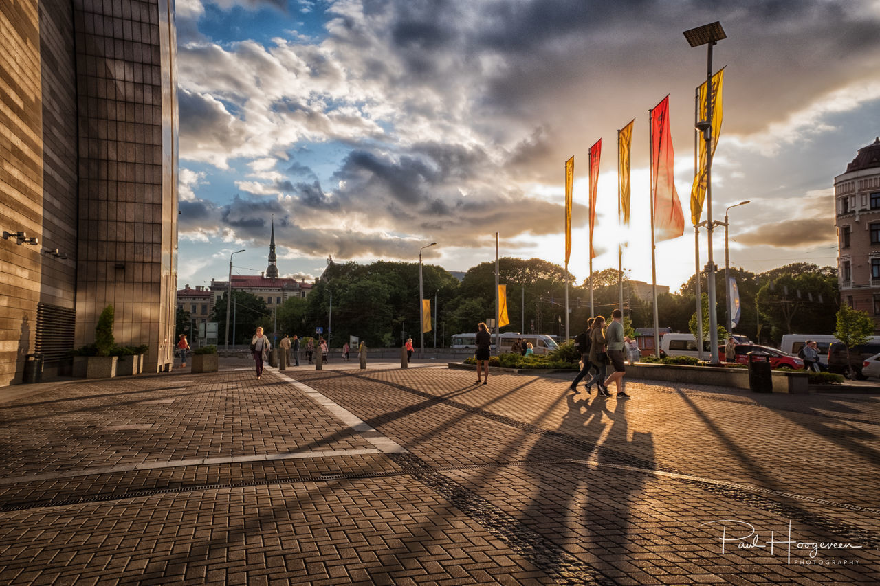Long shadows @ Riga Architecture Building Exterior Built Structure City Citylife Cloud - Sky Day Flag Latvia Light And Shadow Outdoors Real People Riga Sky Urban