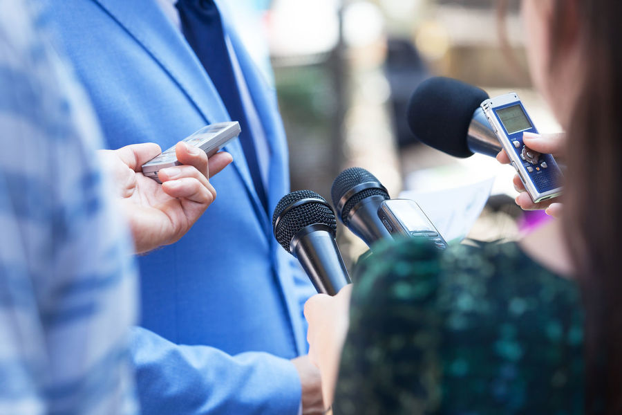 Press interview. News conference. Event Journalist Press Reporting Answering Asking Broadcasting Businessman Bussiness Communication Conference Information Interviewing Journalism Media Microphone News Occupation People Publicity Question Reporter Speaking ınterview
