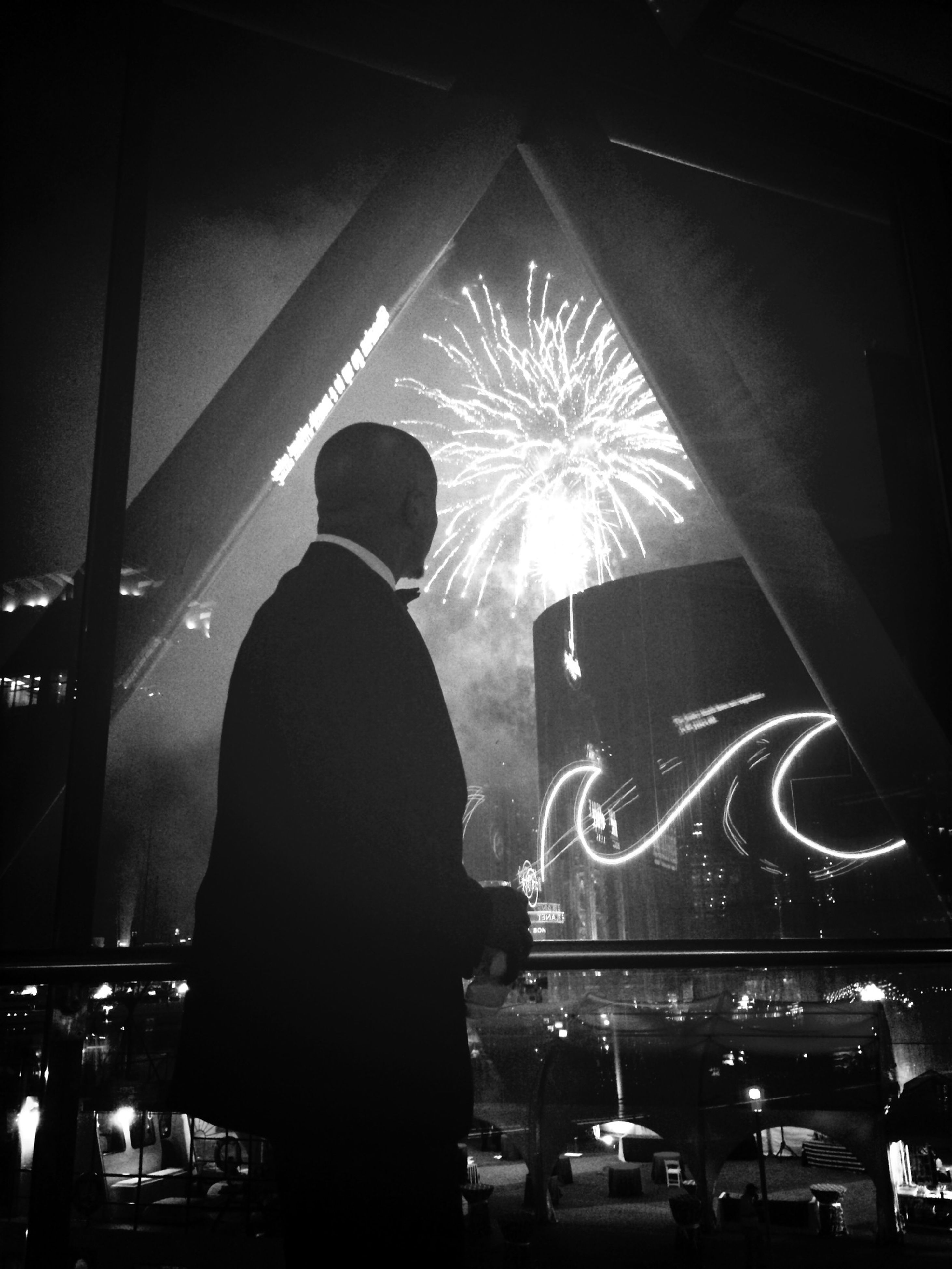 illuminated, night, men, arts culture and entertainment, lifestyles, leisure activity, nightlife, music, event, indoors, rear view, person, silhouette, performance, standing, celebration, stage - performance space, light - natural phenomenon