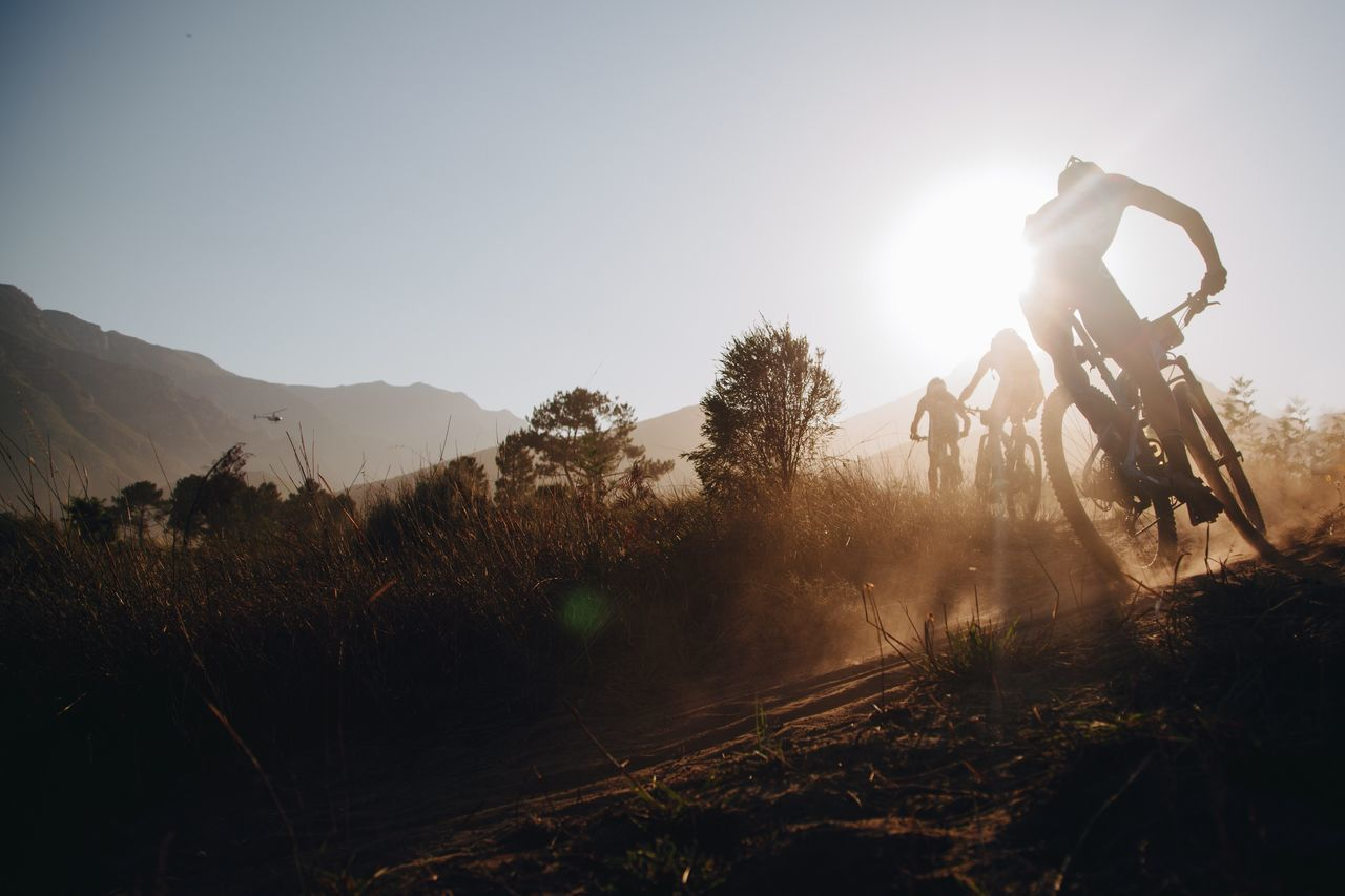 Mountain Bike Weekend Activities Race One Man Only Exercising Sport Adventure Activity Healthy Lifestyle One Person Mountain Bike Lens Flare Bicycle Motion Sunlight Adults Only Extreme Sports Riding Recreational Pursuit Outdoors Leisure Activity Nature