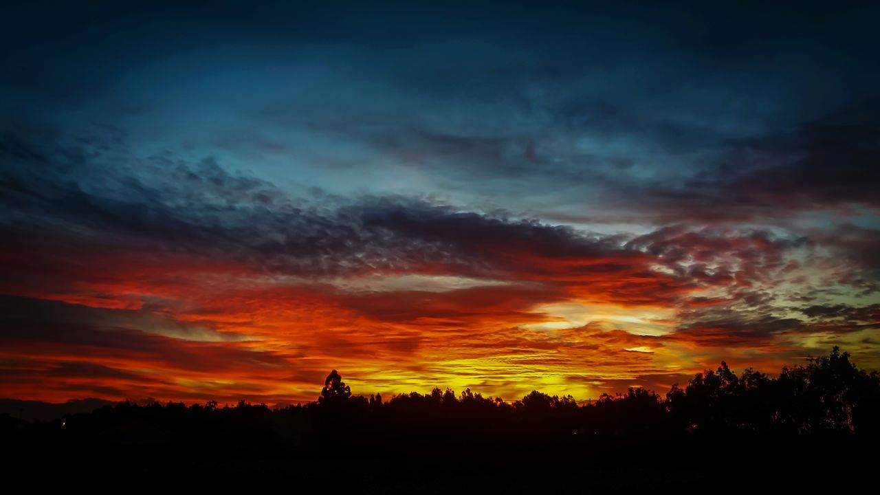 sunset, silhouette, beauty in nature, sky, cloud - sky, dramatic sky, scenics, nature, orange color, tranquil scene, tranquility, tree, no people, built structure, architecture, building exterior, spirituality, travel destinations, outdoors, landscape, day