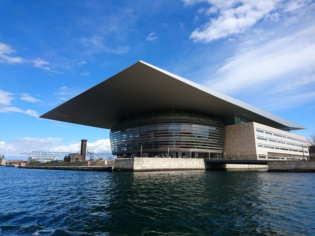 Copenhagen Opera House Architecture Beauty In Nature Blue Built Structure City Cloud Cloud - Sky Cloudy Day Modern Nature No People Opera House Copenhagen Outdoors Rippled Scenics Sky Tranquil Scene Tranquility Water Waterfront