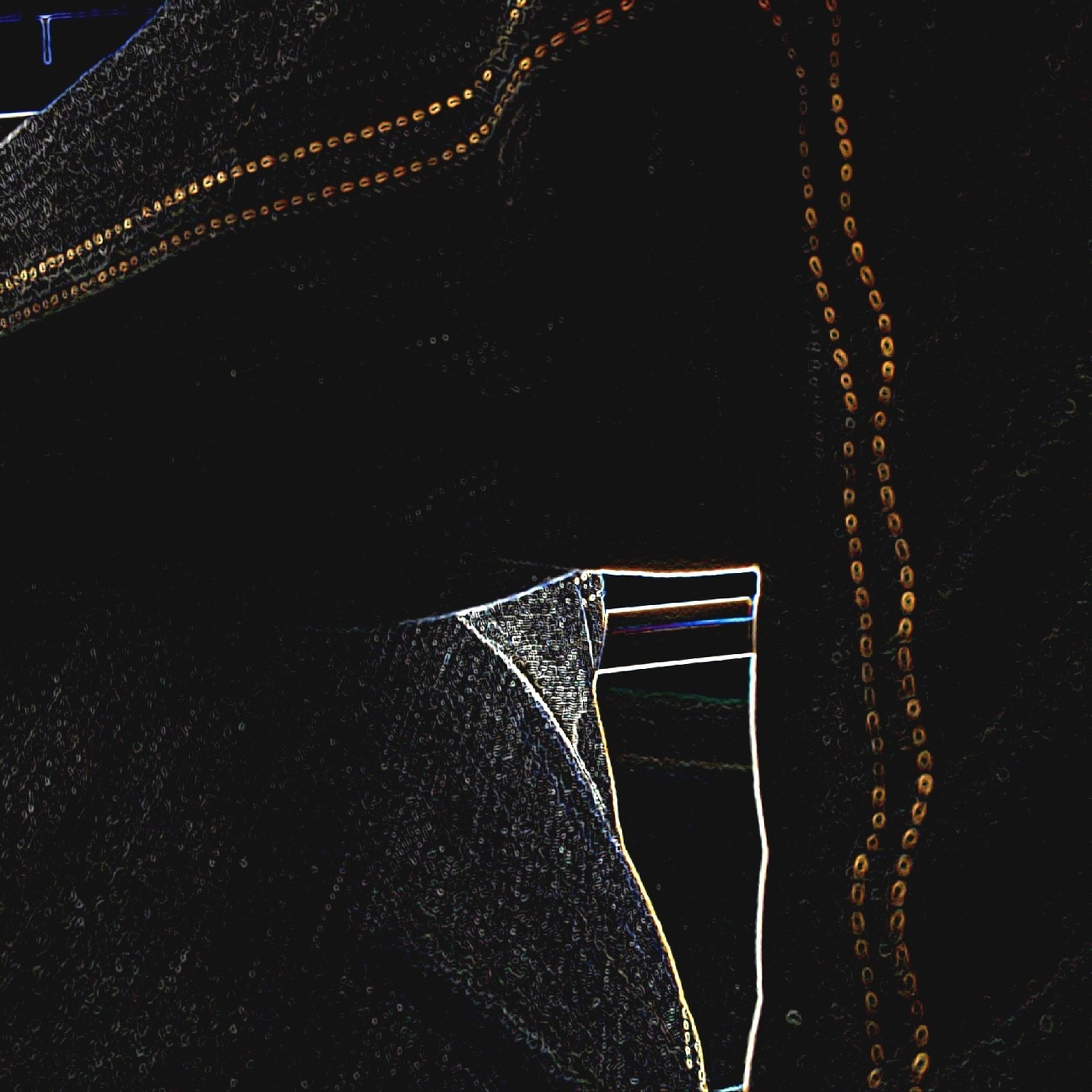 textile, night, one person, indoors, pattern, fabric, dark, close-up, transportation, absence, low section, person, part of, high angle view, illuminated, diminishing perspective, design, empty, shoe