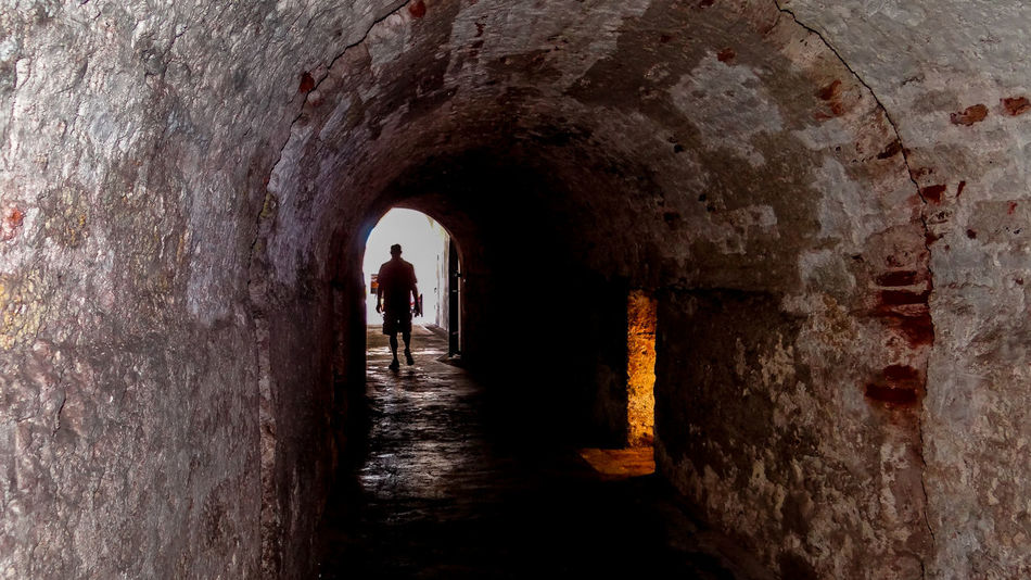 Way out Adult Arch Cave Day Light At The End Of The Tunnel Nature Old Prison One Person Outdoors San Juan Silhouette The Way Forward Tunnel Vacations