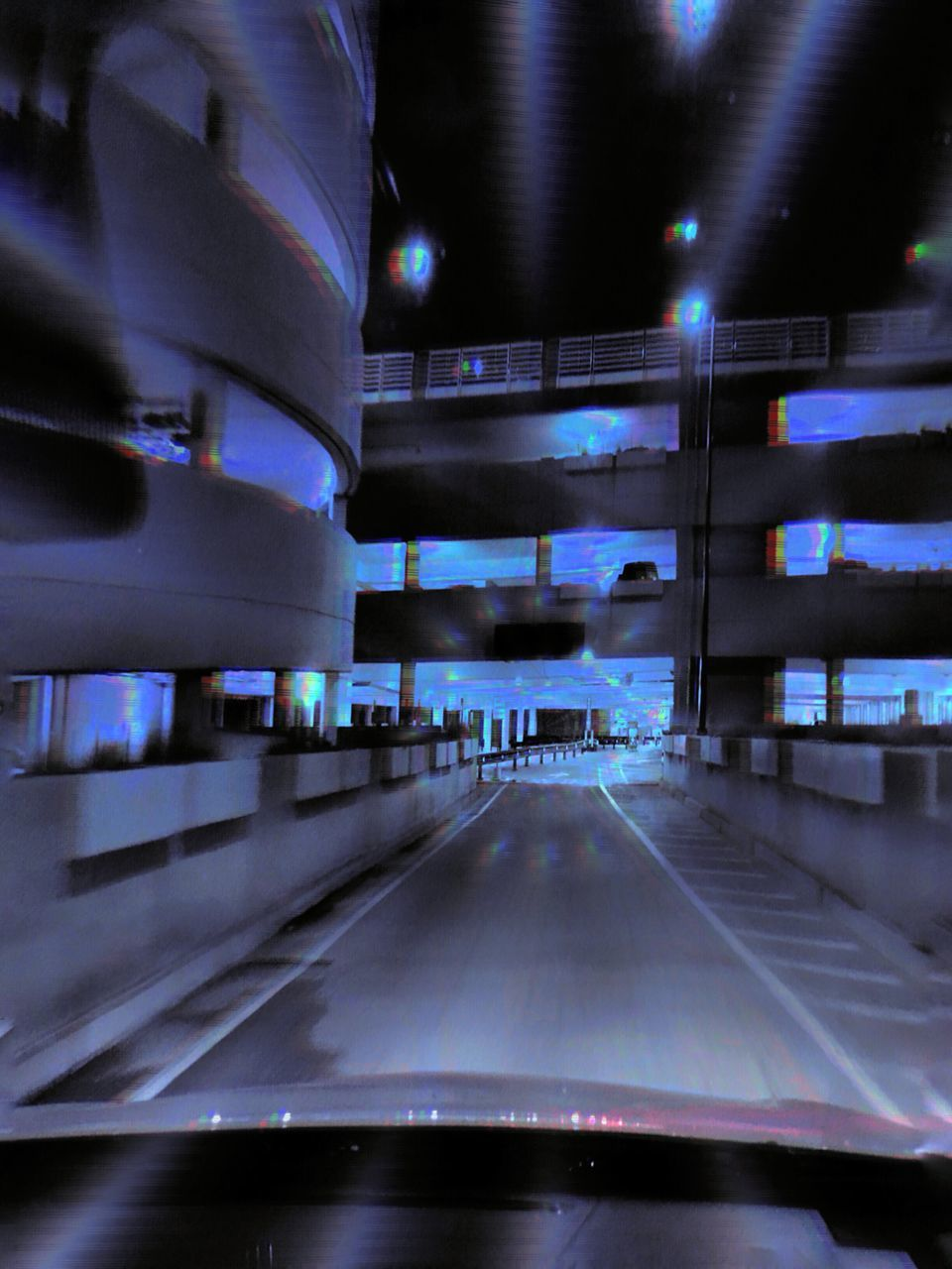 illuminated, transportation, night, the way forward, architecture, built structure, indoors, road, no people, parking garage