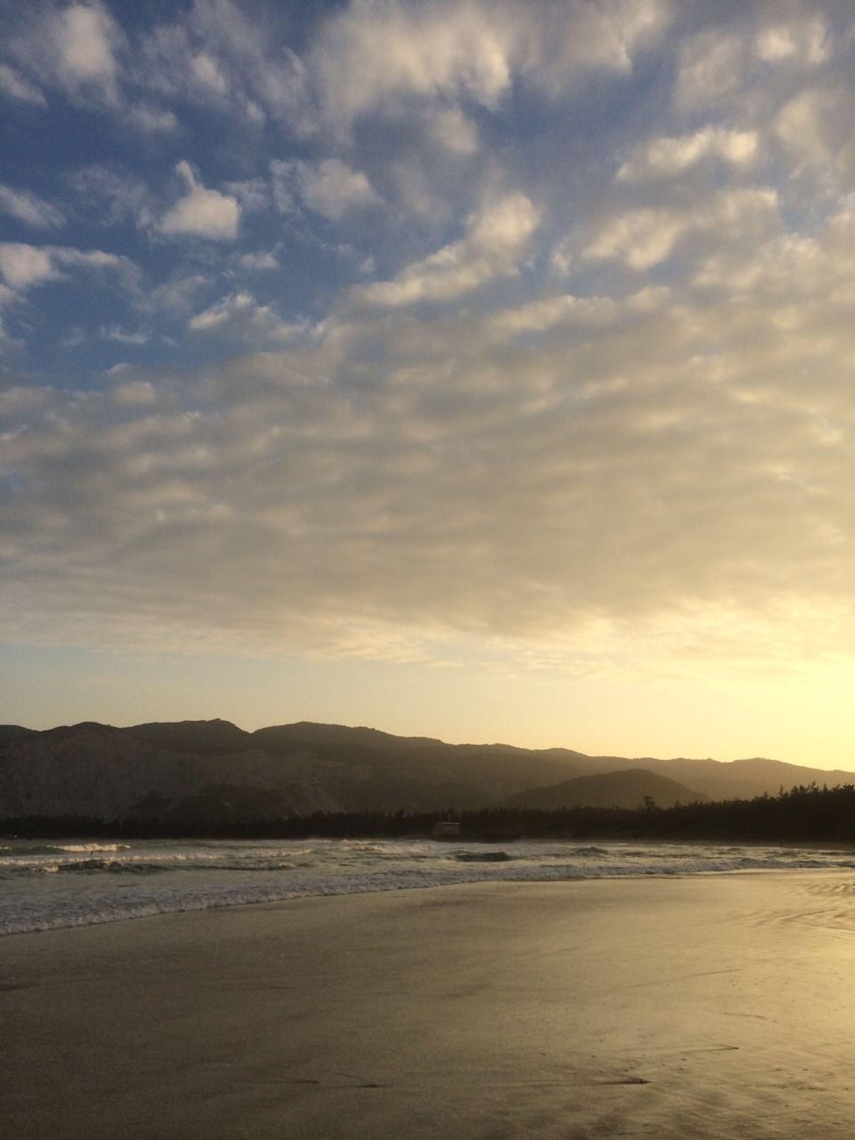 water, sky, scenics, tranquil scene, sea, tranquility, mountain, beauty in nature, cloud - sky, nature, beach, cloudy, idyllic, mountain range, cloud, sunset, waterfront, shore, non-urban scene, dusk