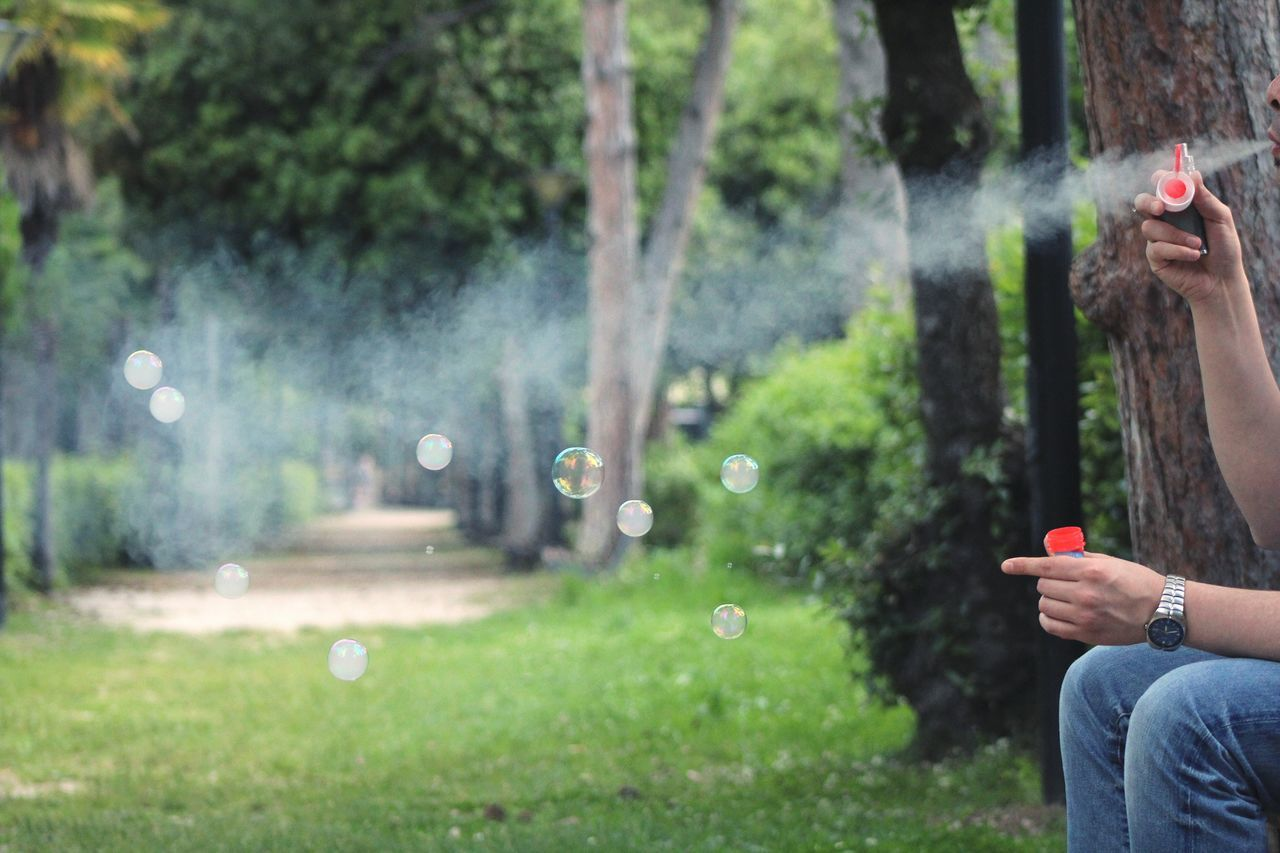One Person Real People People Adults Only Outdoors Human Body Part Day Grass Human Hand One Man Only Nature City Park Vaping Smoke Smoking Time Soap Bubbles Chance Encounters