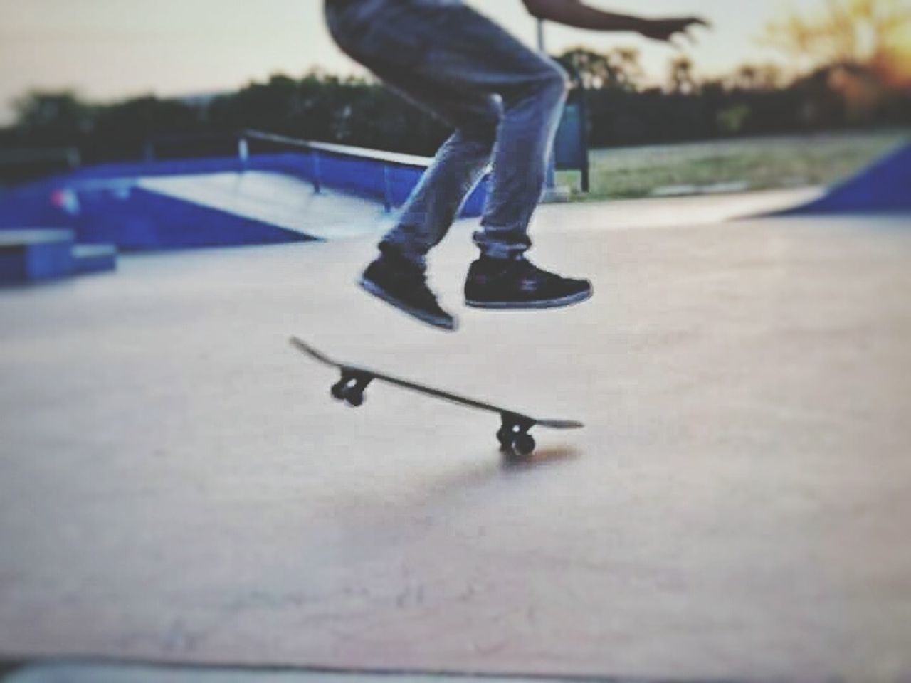 low section, leisure activity, skill, sport, balance, skateboard, real people, skateboard park, one person, lifestyles, skating, ice rink, day, ice skate, weekend activities, ice-skating, human leg, sports ramp, outdoors, winter sport, playing, extreme sports, people