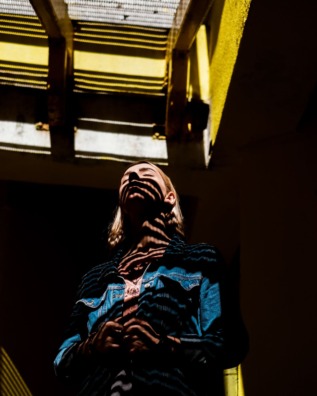 Shadow play One Person Real People Shadows & Lights Light Calmness Yellow Portrait Of A Woman Street Nice Creativity Creative Light And Shadow
