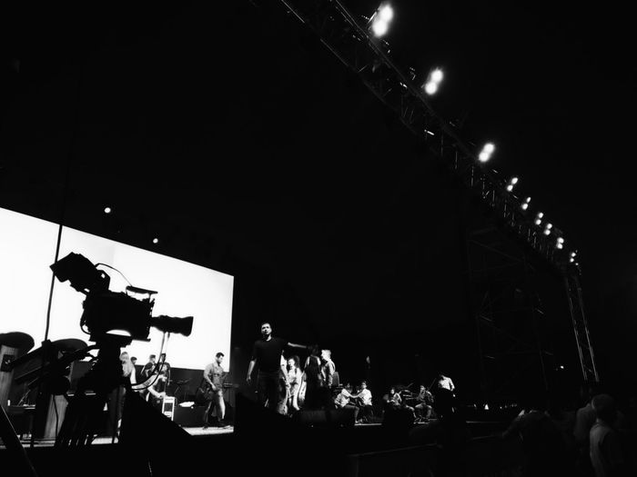 Lights... Camera... Showtime!! Illuminated Arts Culture And Entertainment NightBlack & White Low Angle View People Popular Music Concert Travel Photography Outdoors B/w