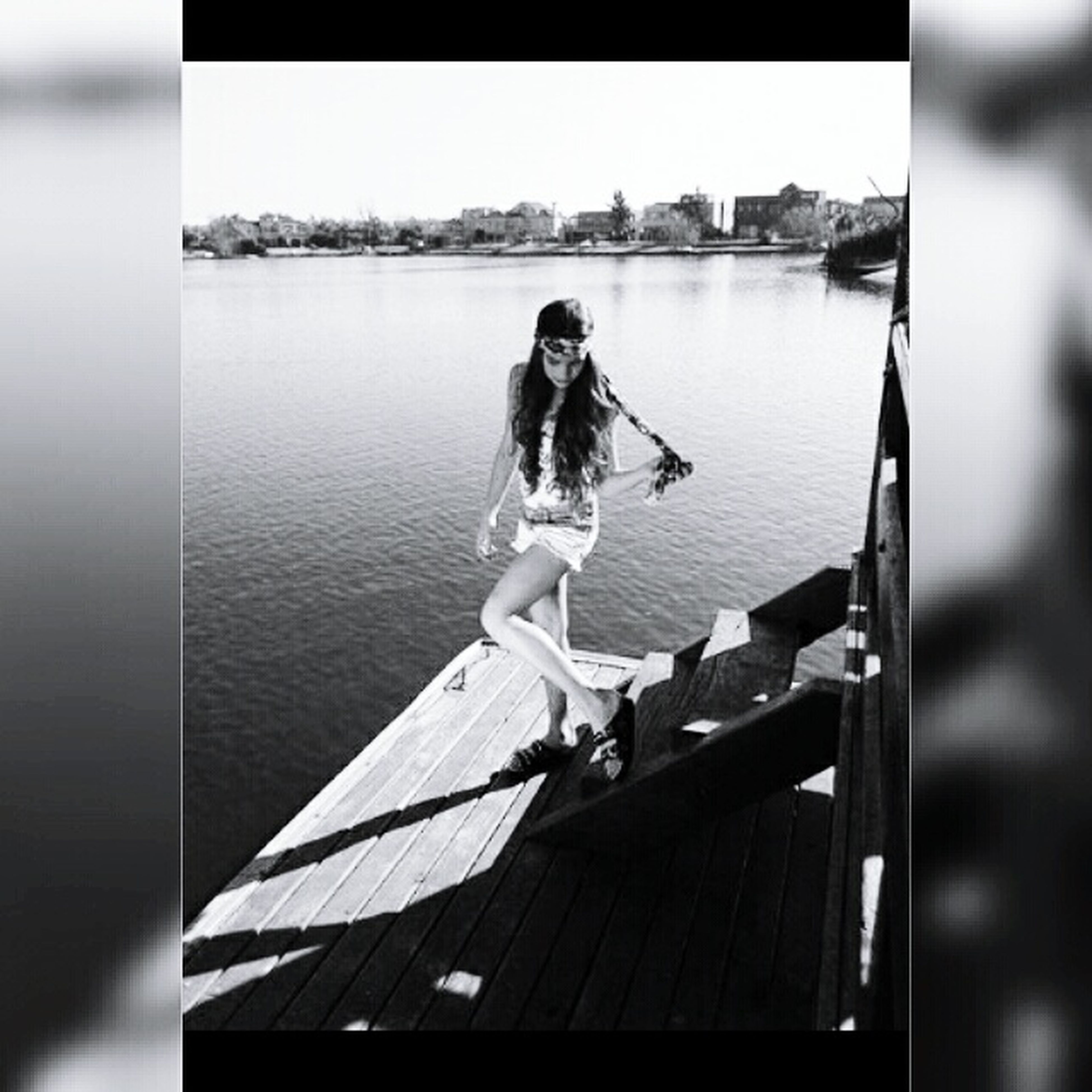 water, lifestyles, leisure activity, full length, nautical vessel, casual clothing, sitting, young adult, standing, boat, person, reflection, lake, rear view, three quarter length, holding, railing, side view