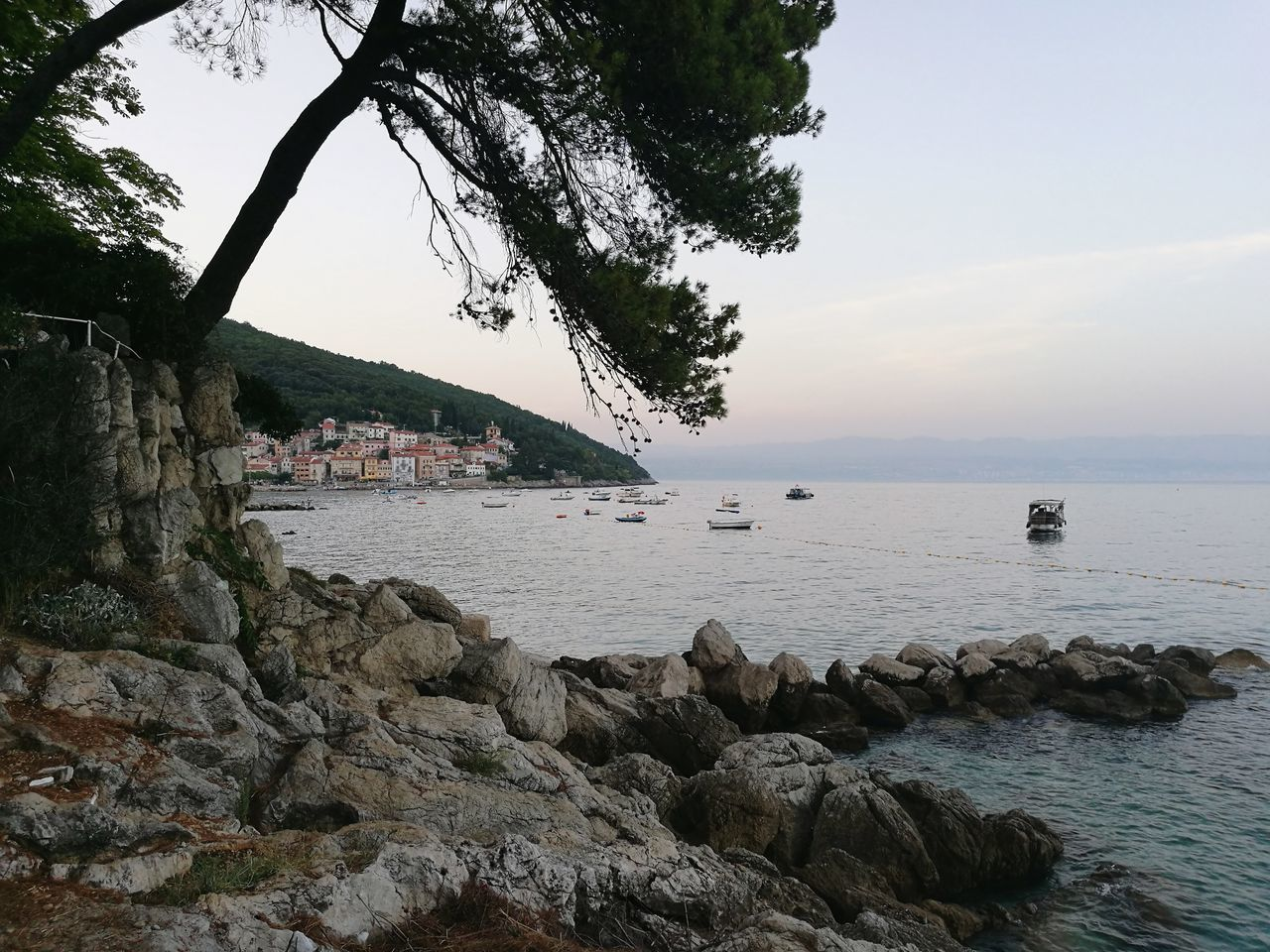 water, sea, tree, nature, rock - object, beauty in nature, scenics, outdoors, tranquility, sky, tranquil scene, beach, day, built structure, no people, horizon over water, architecture, nautical vessel