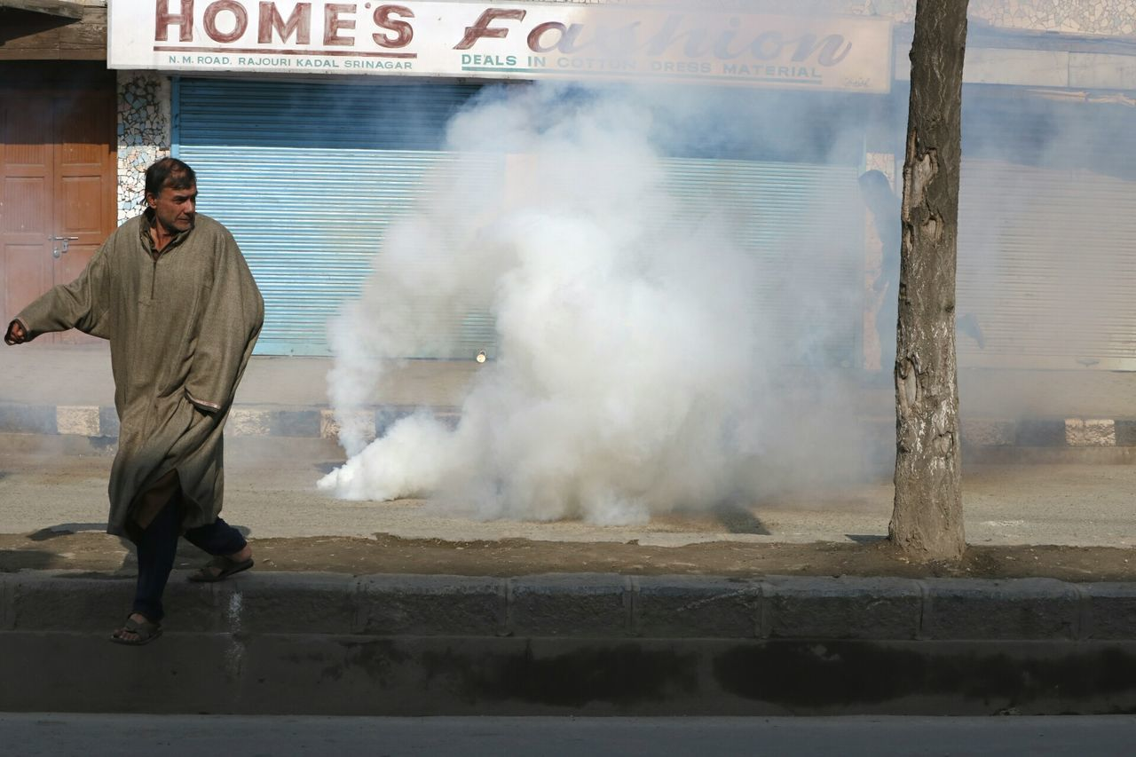 A man runs away as the teargas canister is shot and seen in picture exploded, by the indian forces towards the kashmiri youth (not in picture) at downtown srinagar when youth was fighting back to the inian forces in indian controlled kashmir! Firefighter City Only Men Senior Adult Outdoors Adults Only Men Kashmir Mobile Conversations Army Base Stones War Adult Full Length Day ExplosiveRoomMix Explosive AJEInPictures People EyeEmNewHere
