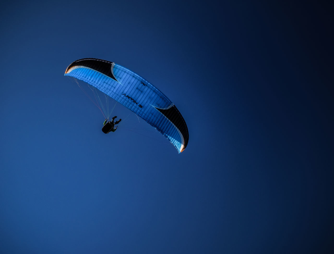 Into the Blue again Adventure Blue Carefree Clear Sky Dark Exhilaration Extreme Sports Flying Gliding Leisure Activity Lifestyles Low Angle View Mid-air Nature Parachute Paragliding Skydiving