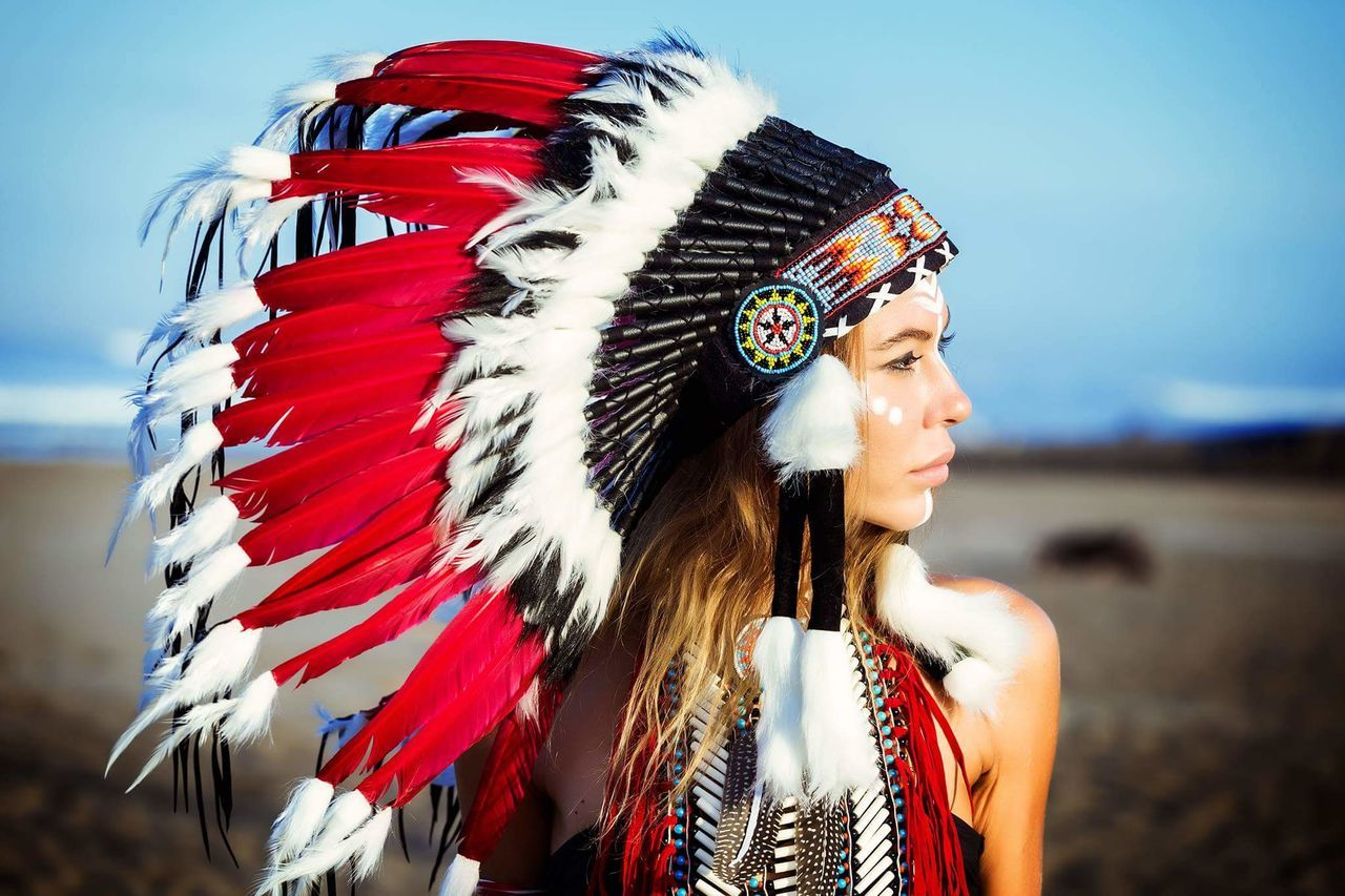Mid Adult Only Women Mid Adult Women One Person One Woman Only Adults Only Adult Red Front View People Portrait Day Outdoors Feather  Headshot Women Real People Headdress Beautiful Woman One Young Woman Only Warbonnet Native American Indian Bali Indonesia Live For The Story