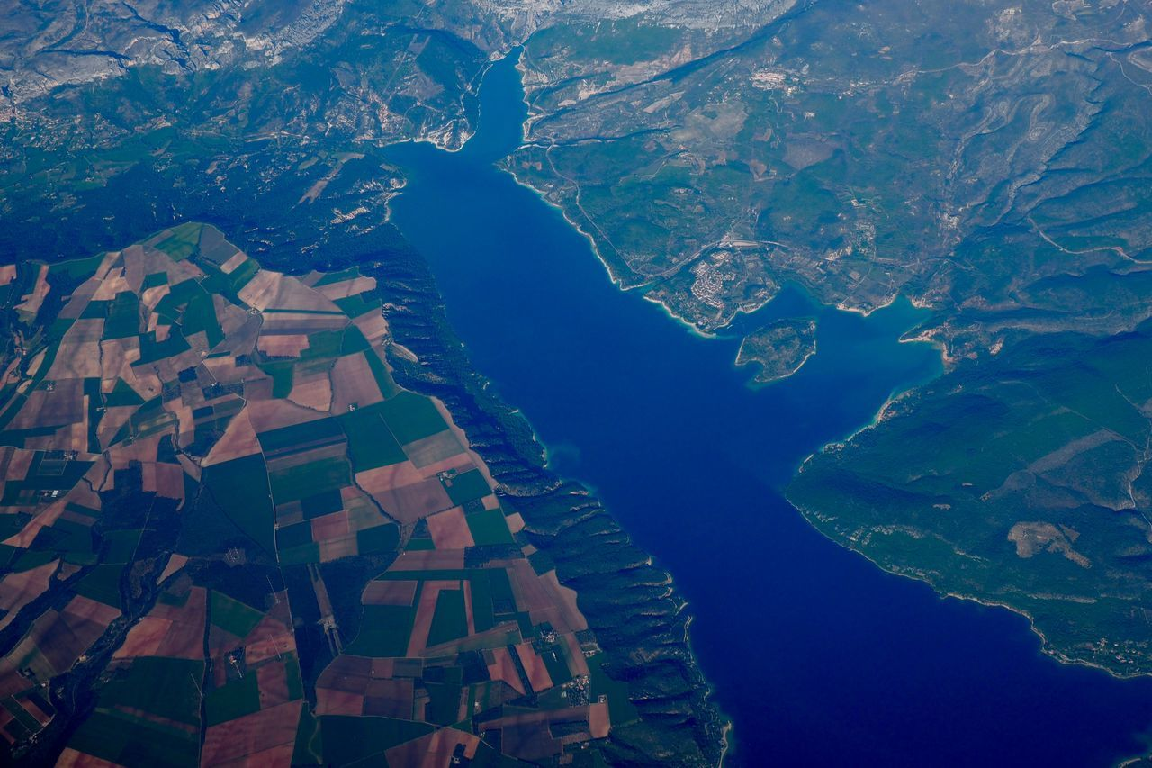 How beautiful the world is from up here..... Aerial View Agriculture Airplane Airplaneview Beauty In Nature Day Farming From Above  Green Lake Mountain Nature No People Outdoors