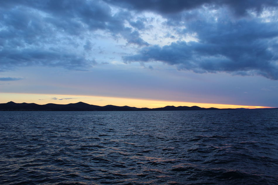 Beauty In Nature Dark Holiday Nature No People Outdoors Sea Sky Sunset Tranquil Scene Water