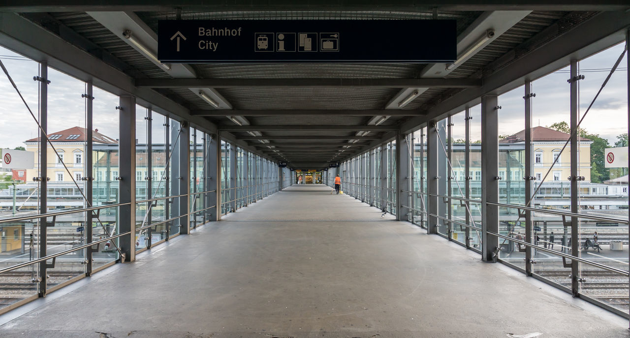 Bahnhof Station Architecture Bridge Bridge - Man Made Structure Built Structure Covered Bridge Day Diminishing Perspective Indoors  One Person Pedestrian Symmetry The Way Forward Train Station Transportation Walkway