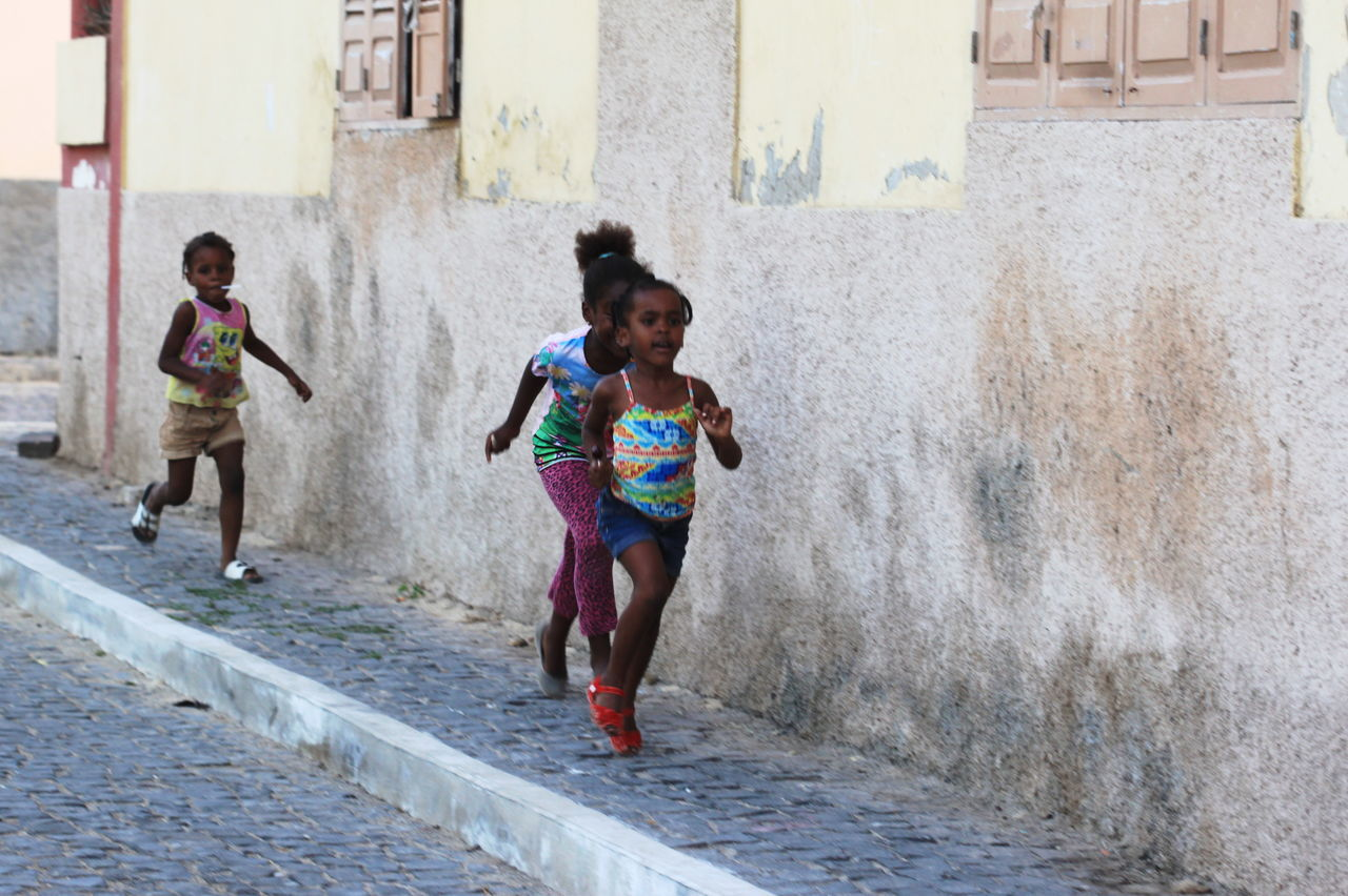 Building Exterior Capo Verde Childhood Day Elementary Age Friendship Full Length Girls Motion Outdoors Playing Real People Running Sal Island Santa Maria Summer 2015 The Street Photographer - 2017 EyeEm Awards Togetherness