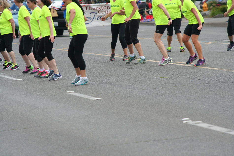 4th Of July 2016 4th Of July Parade Casual Clothing Celebration City Life Crowd Dance Day Enjoyment Fun Group Of People Jazzercise Large Group Of People Leisure Activity Lifestyles Medium Group Of People Mixed Age Range Outdoors Parade Selective Focus Sport