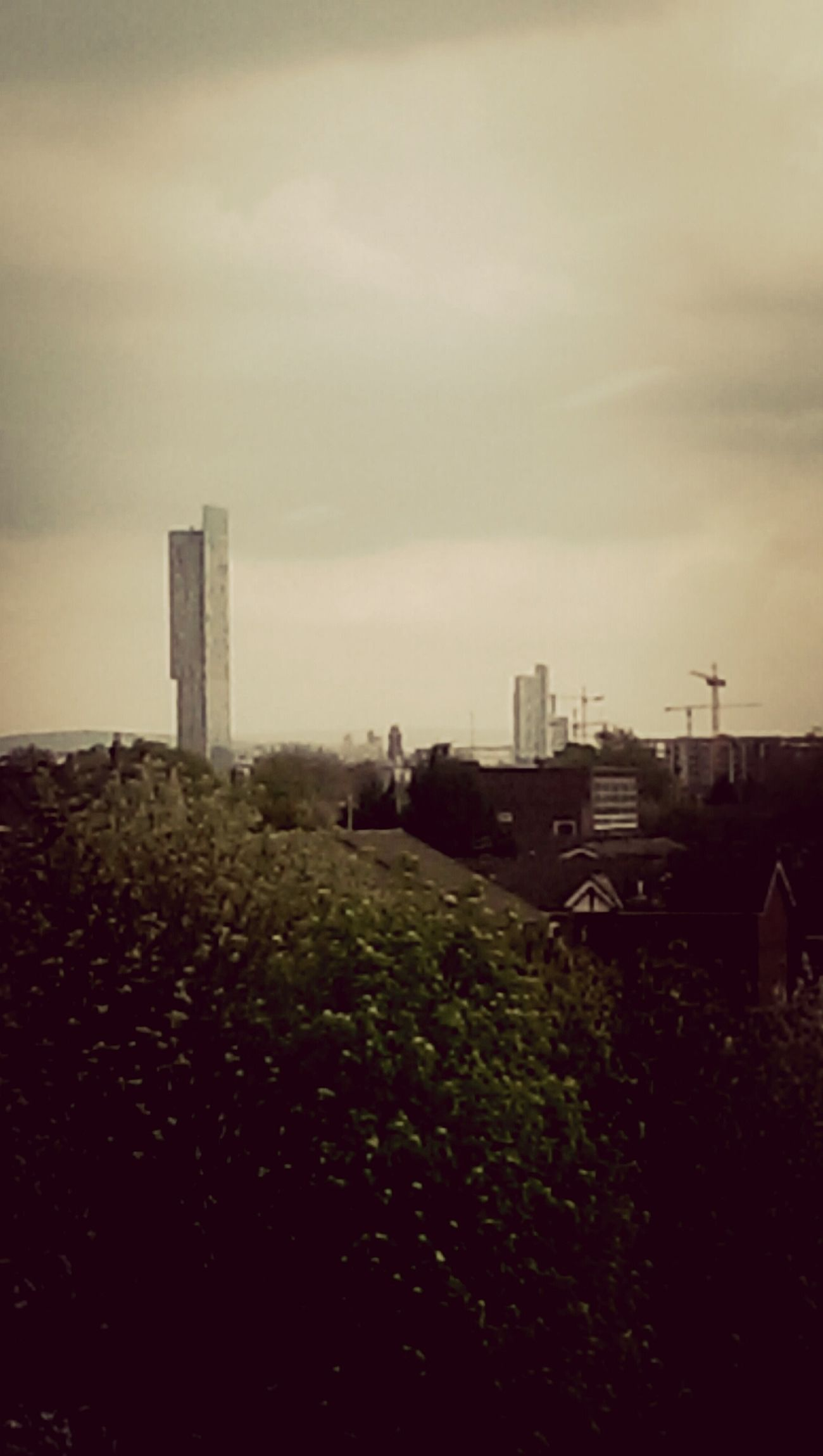 tha Manchester skyline on an overcast Monday evening