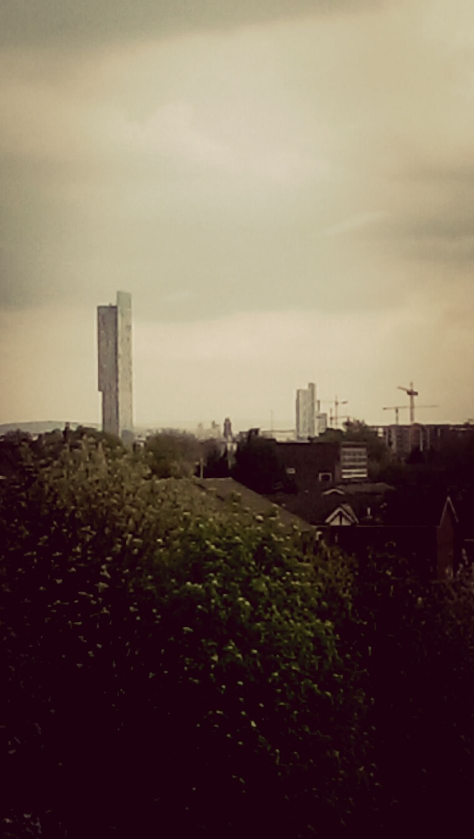 tha Manchester skyline on an overcast Monday evening