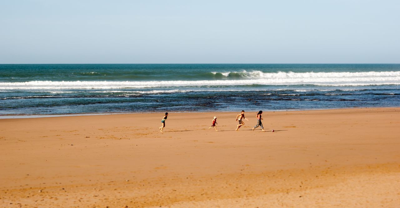 Beach Childhood Children Day Football Horizon Over Water Nature Ocean Ocean View Outdoors People Sand Sea Sky Water Wave