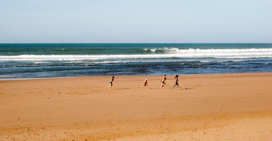 Beach Childhood Children Day Football Horizon Over Water Nature Ocean Ocean View Outdoors People Sand Sea Sky Water Wave