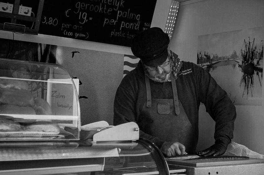Bruinisse [NL] Fisherman's Days 2017 Food Fish Foodtruck Fisherman Preparing Food EyeEm Selects Blackandwhite Black And White Black & White Interaction Foodstall Market Stall Man Food Stall Streetphotography Street Photography Vending Market The Week On EyeEm Food Stories