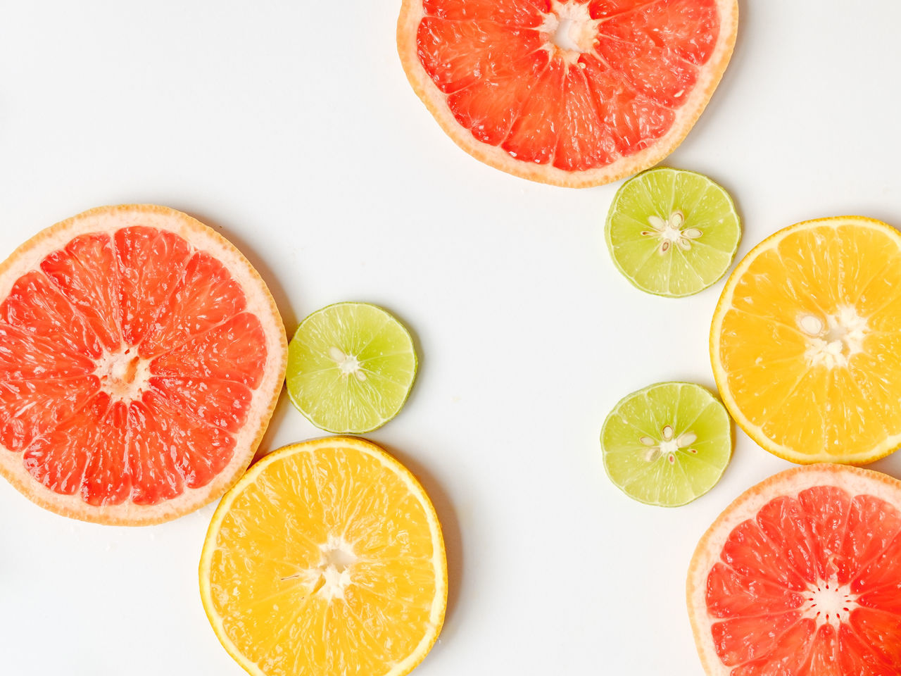 Blood Orange Circles Citrus Fruit Close-up Cross Section Directly Above Food Food And Drink Freshness Fruit Geometric Shape Geometry In Nature Grapefruit Healthy Eating High Angle View Indoors  Lemon Lime No People Orange Fruit SLICE Sour Taste Studio Shot White Background