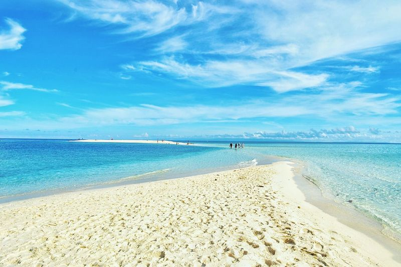 Sandbed Beach Sea Water Tranquil Scene Sand Scenics Tranquility Blue Shore Sky Beauty In Nature Vacations Tourism Idyllic Seascape Travel Destinations Nature Philippines Coastline Non-urban Scene Tide