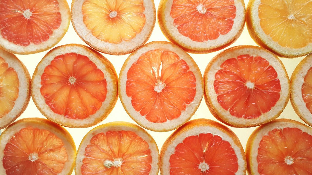 Healthy Eating Grapefruit Full Frame Citrus Fruit Food SLICE Freshness Symmetry Fruit Slices Directly Above White Background Healthy Food Background Blood Orange Close-up Geometric Shapes Circles Cross Section Pattern Natural Pattern Backgrounds High Angle View Citrus  Still Life