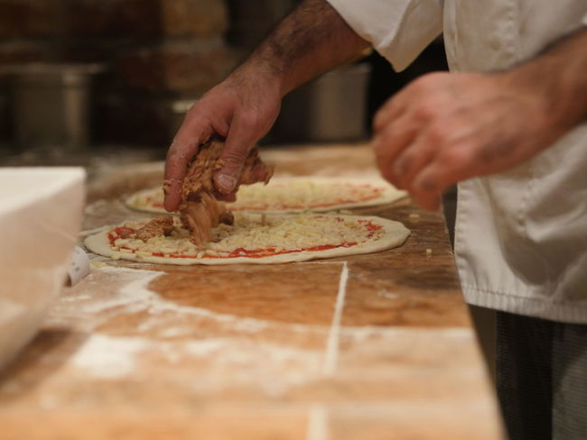 Baker Baking Cooking Food Food And Drink Freshness Indoors  Making Music Pizza Preparation  Preparing Preparing Food Selective Focus
