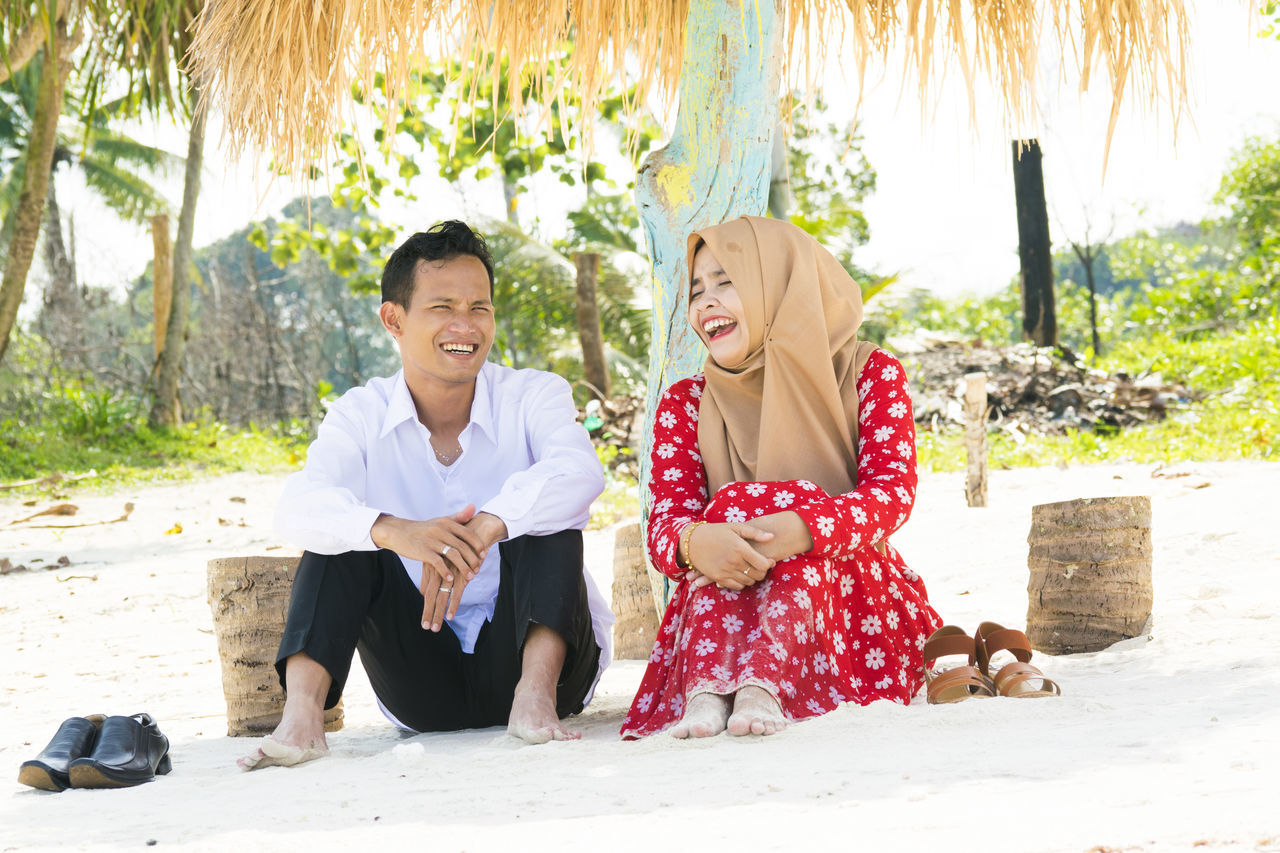 Enjoy The New Normal Relationship Beyonce Couple Candid Laughing Moments Beach Confidence  Travel Travelingindonesia Outdoors Romantic❤ Romantic Free Couples Traveling Beachphotography Nature Beauty In Nature Candid Portraits
