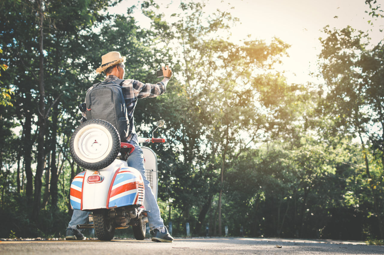 Adult Age Day Hipster Holiday Let's Go. Together. Men Motorcycle Nature One Person Outdoors People Real People Roadtrip Scooter Sunlight Tree Variation Vintage