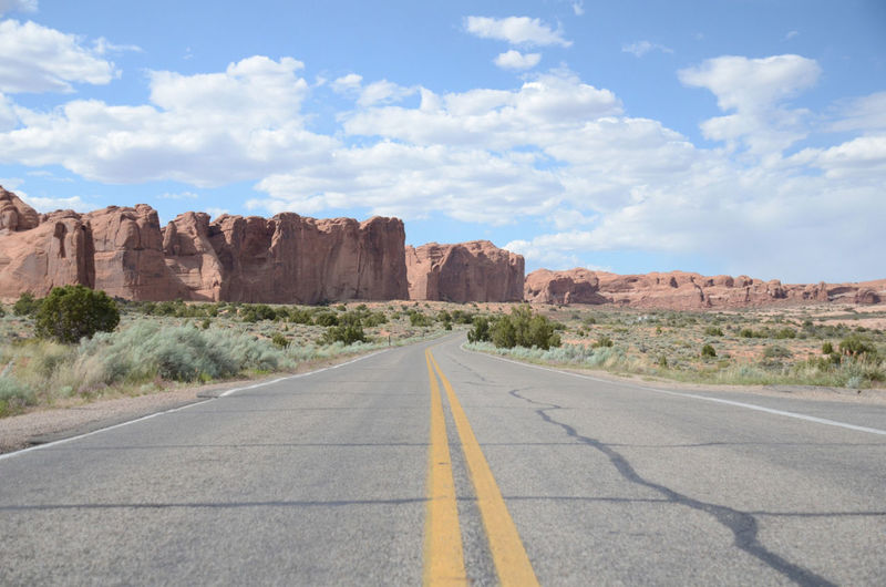 The road through Arches National Park. Arches National Park Arches National Park, Utah Arches R Cloud - Sky Cloudy Double Yellow Line Escape Escaping Explore Landscape Mountain Natgeo Non-urban Scene Road Road Trip Roadtrip Sky Travel Travel Photography Traveling