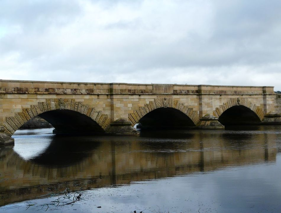Historic Ross Bridge Tasmania 1836 Arch Arch Bridge Architecture Australia Bridge Bridge - Man Made Structure Built Structure Connection Day Engineering Historic Historical Sights Nature No People Outdoors River Ross Bridge Sky Tasmania Tranquility Water