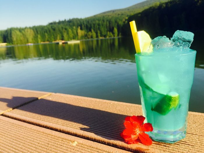 Food And Drink Drink Refreshment Water Table Drinking Glass Freshness Lake Summer Mountain Tranquility Vacations Temptation Serving Size Green Color No People