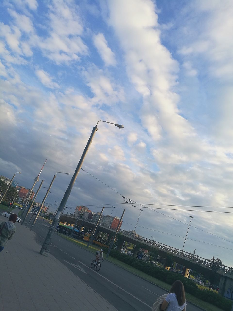 cloud - sky, sky, transportation, airport, land vehicle, air vehicle, airplane, airport runway, day, outdoors, men, architecture, real people, city, people