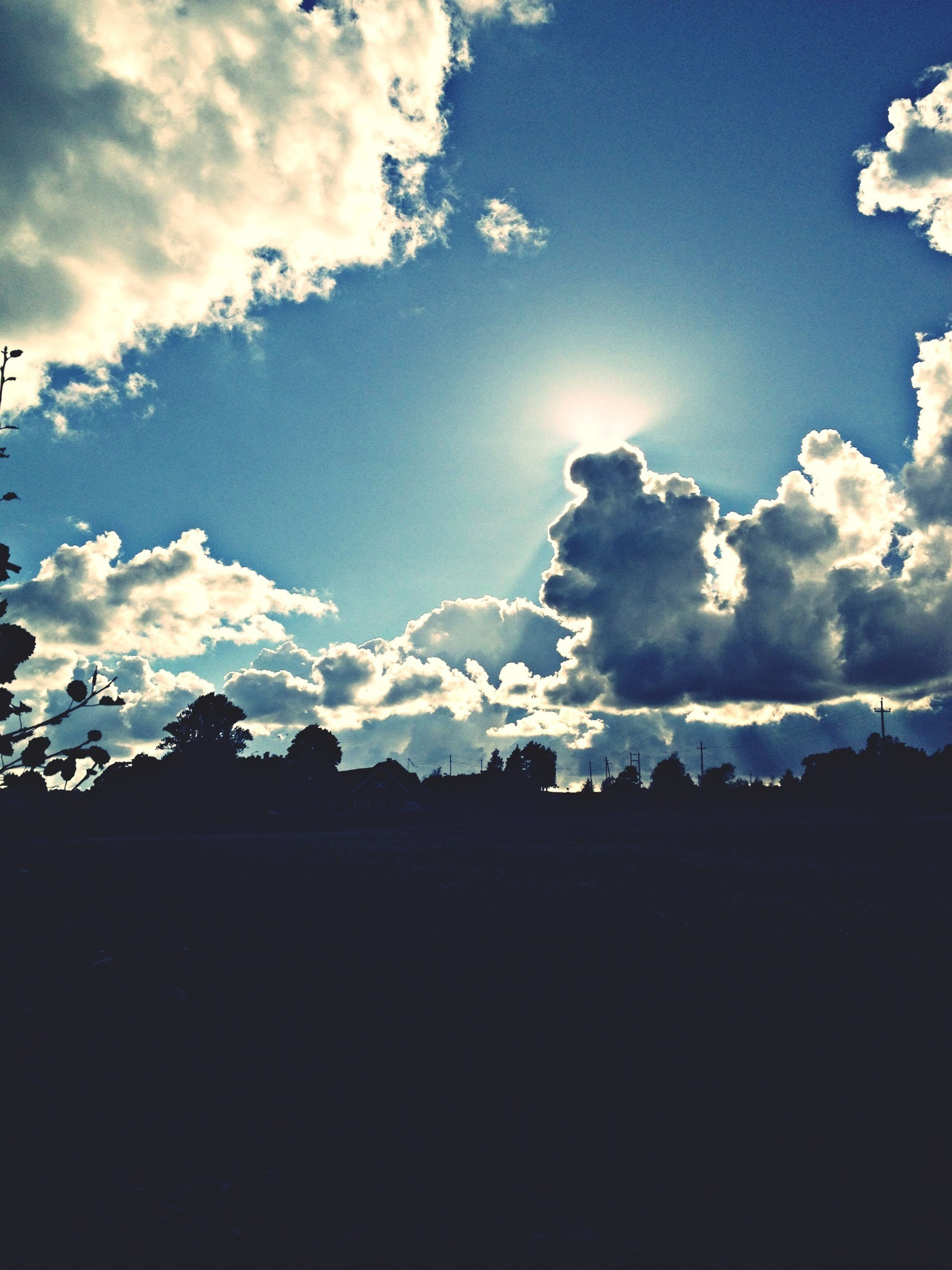sky, cloud - sky, blue, silhouette, cloud, tranquility, tranquil scene, scenics, beauty in nature, nature, cloudy, landscape, low angle view, sunlight, outdoors, idyllic, tree, no people, field, dusk